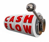 Cash Flow words on slot machine wheels or dials as money or income earned for your budget or finances