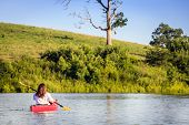 stock photo of bluegrass  - Kayaking on a lake - JPG