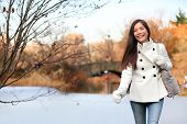 picture of candid  - Woman walking happy in Central park - JPG