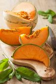 cantaloupe melon sliced on wooden background