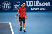 SEPTEMBER 26, 2014 - KUALA LUMPUR, MALAYSIA: Kei Nishikori of Japan reacts after playing a return in his match at the Malaysian Open Tennis 2014. This event is an ATP sanctioned tournament.
