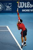 SEPTEMBER 26, 2014 - KUALA LUMPUR, MALAYSIA: Kei Nishikori of Japan serves in his match at the Malaysian Open Tennis 2014. This event is an ATP sanctioned tournament.