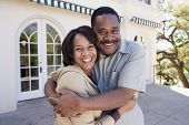 African American couple hugging outdoors