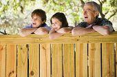 Hispanic family laughing outdoors