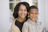 African American mother and son smiling
