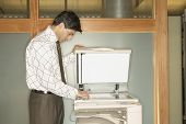Businessman using copy machine
