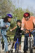 Hispanic parents and son riding bicycles