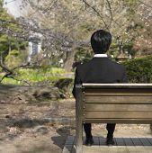 Businessman sitting on park bench