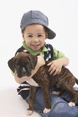 Young African boy holding puppy