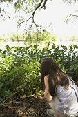 Hispanic girl looking at plants