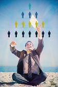Victorious young businessman juggling with his tablet with business management infographic