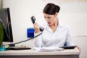 Angry woman shouting at phone