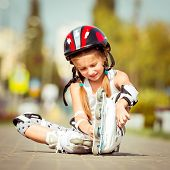 little cute happy little girl putting rollers
