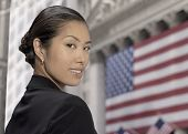 stock photo of japanese flag  - Asian businesswoman in front of American flag - JPG