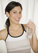 Hispanic woman holding bottled water