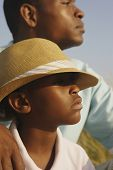 Close up of African father and son at beach