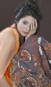 Hispanic girl with hand covering eye