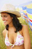 Woman wearing bikini top and straw hat