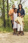 picture of nuclear family  - African family smiling in park - JPG