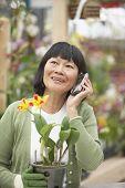 Senior Asian woman talking on cell phone