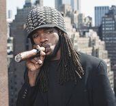 African man smoking large cigar