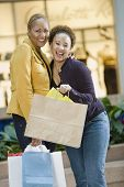 image of chums  - Mixed Race women with shopping bags - JPG