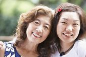 Portrait of Asian mother and adult daughter