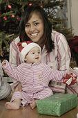 Hispanic mother and baby on Christmas