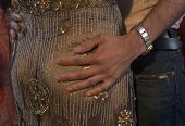 Close up of man's hand on woman's buttocks