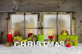 Christmas greeting card or background with red candles, letters and green gift boxes.