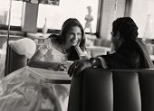 Bride and groom eating at diner