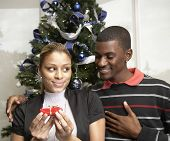 African man giving gift to girlfriend