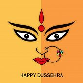 Illustration of Goddess Durga face wearing nose ring with stylish text on double coloured background.