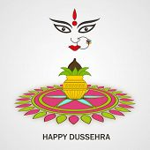 Illustration of colourful rangoli and a decorated traditional pot with coconut and face of Goddess Durga.