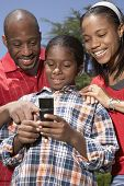 African family looking at cell phone