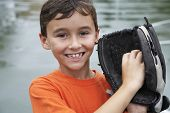 Boy wearing baseball mitt