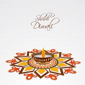 Illustration of a colourful rangoli and a decorated illuminated lampion with stylish text.