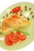food : vegetable casserole triangle on green plate with cheese and tomatoes isolated on white