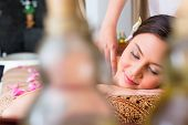 Chinese Woman having wellness massage with essential oils