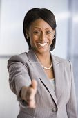 African American businesswoman extending hand to shake