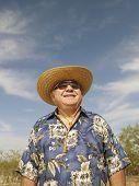 Senior Mixed Race man wearing sunhat