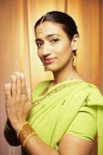 Indian woman with hands together