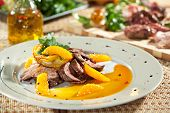 Duck Breast with Orange and Potato. Garnished with Orange Sauce and Parsley