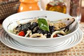 Pasta with Calamari Rings, Mussels, Tiger Shrimps, Cherry Tomatoes and Basil