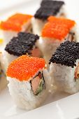 Maki Sushi with Salmon, Cucumber and Tamago inside. Topped with Tobiko