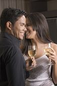 Hispanic couple drinking wine