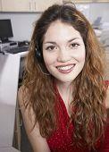 Hispanic businesswoman wearing headset
