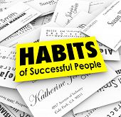 Habits of Successful People words on business card stack to illustrate techniques of powerful and advanced career professionals