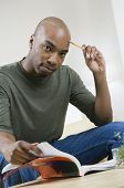 African American man reading text book