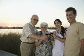 Multi-generational Hispanic family toasting with wine